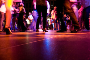 young people dancing on a dancing floor at night