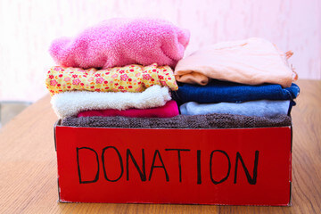 Colorful towels in a red donation box