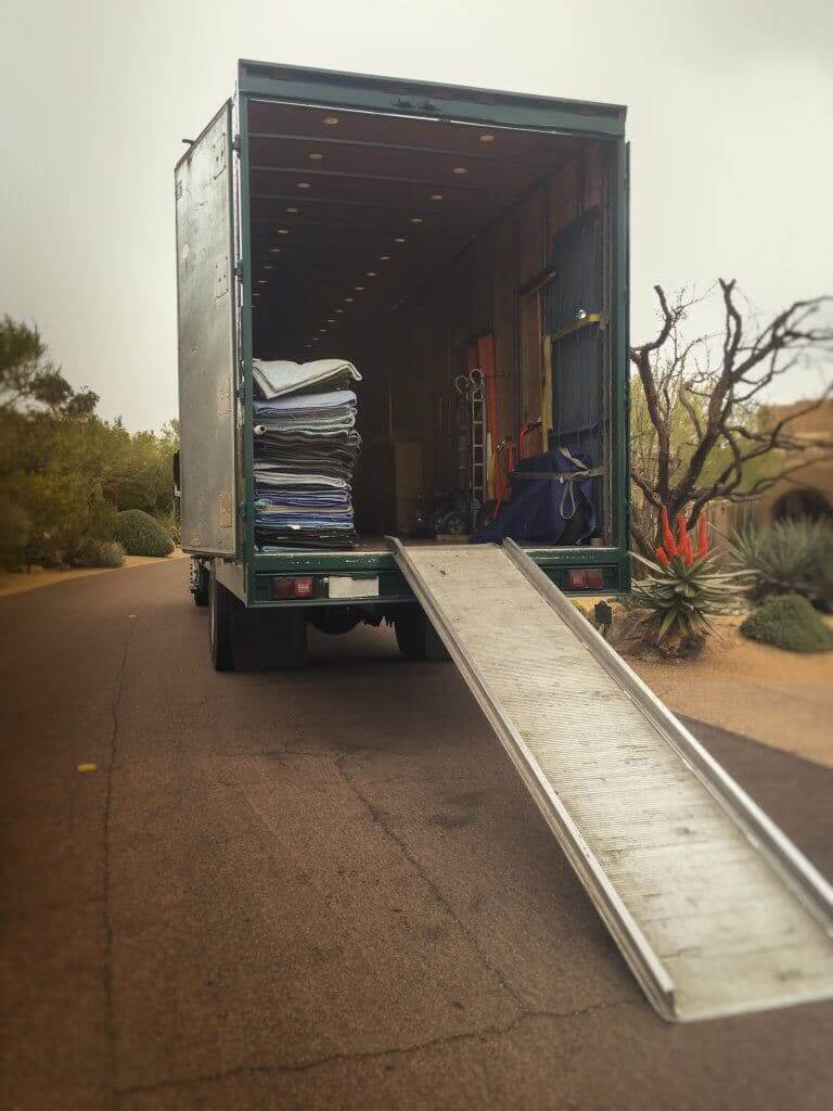 A moving truck unloading the furniture