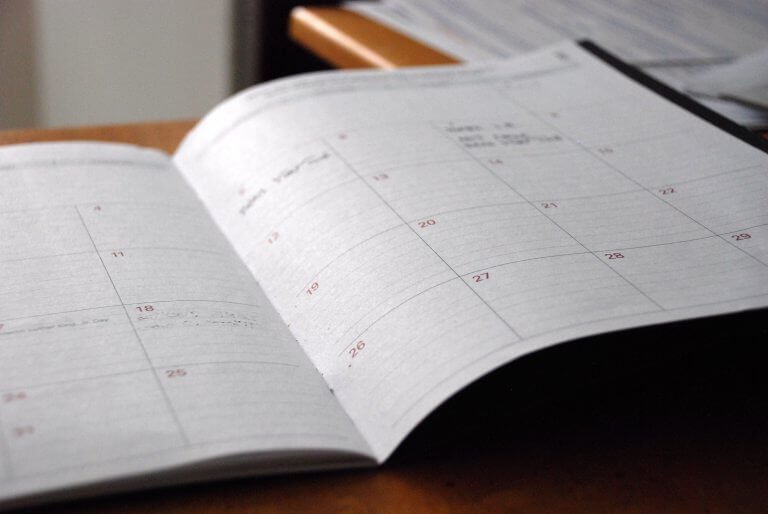 A calendar with schedule on the desk
