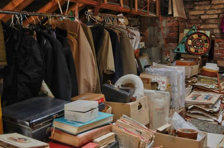 Clothes, boxes and old objects in basement