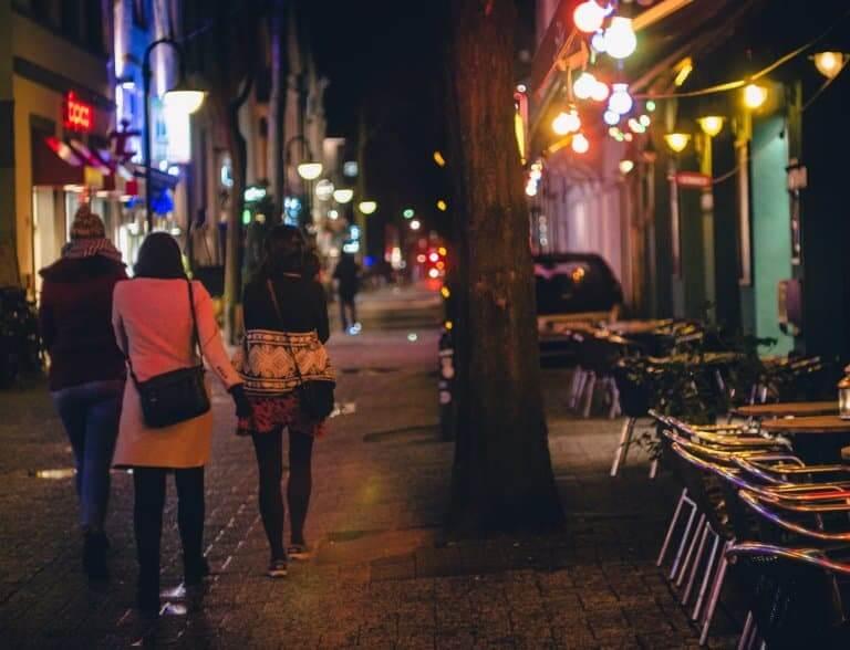 Young people walking around neighborhood at night