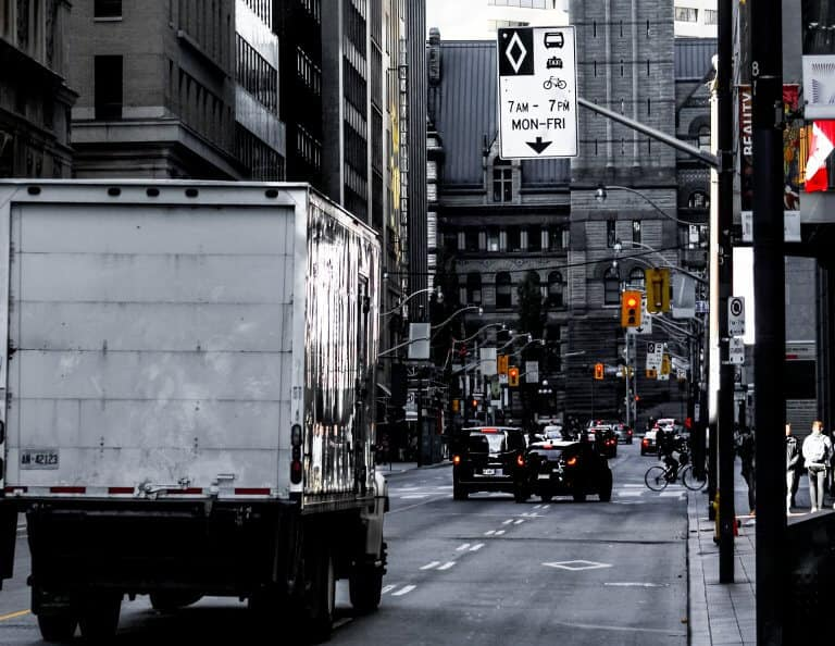 A moving truck driving on the street