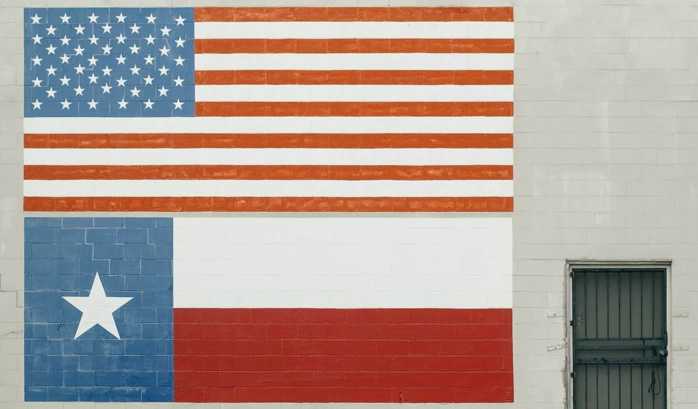Texas and U.S flag on wall