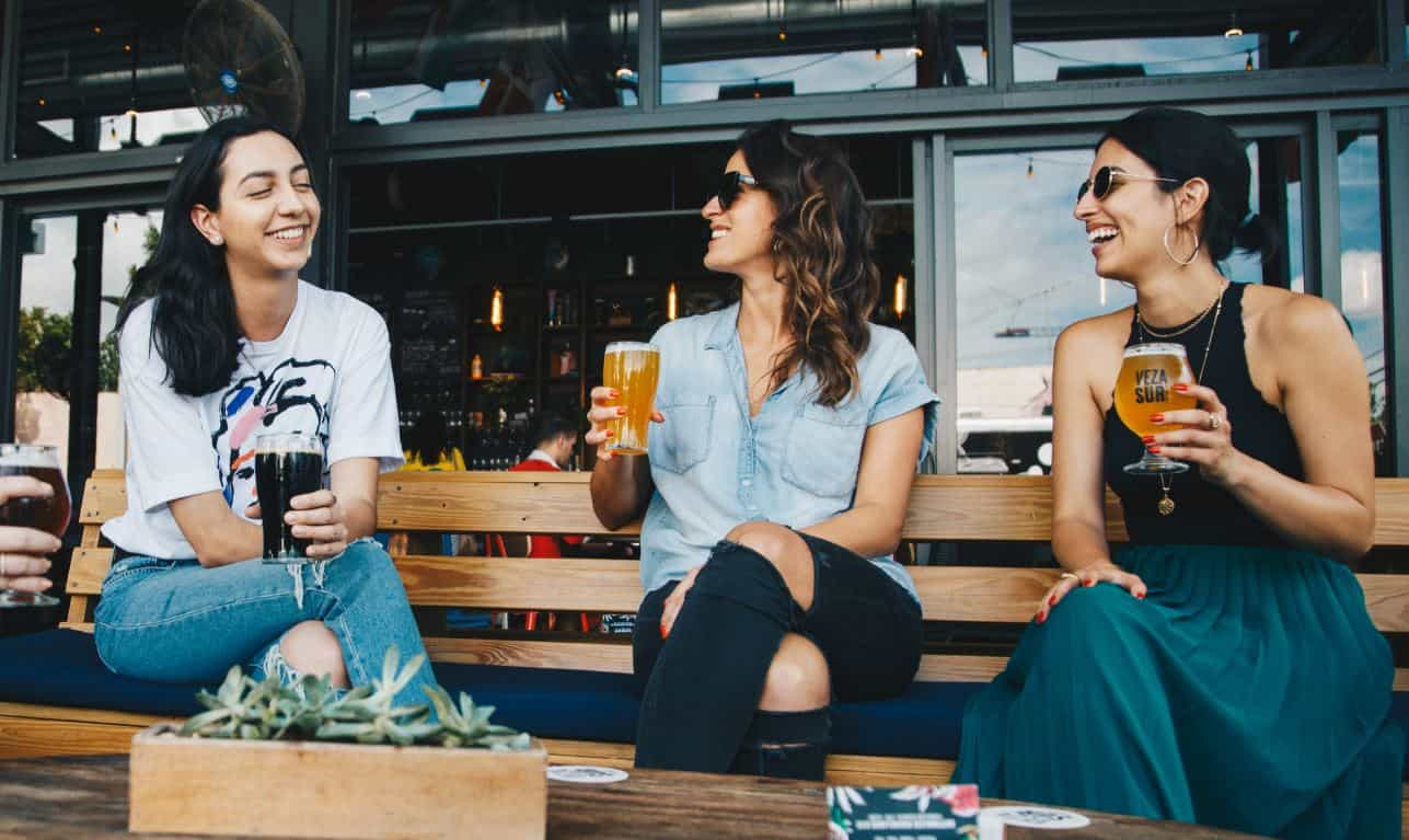 Women drink beer at the patio of the NYC local bar