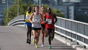 Five guys running during a marathon