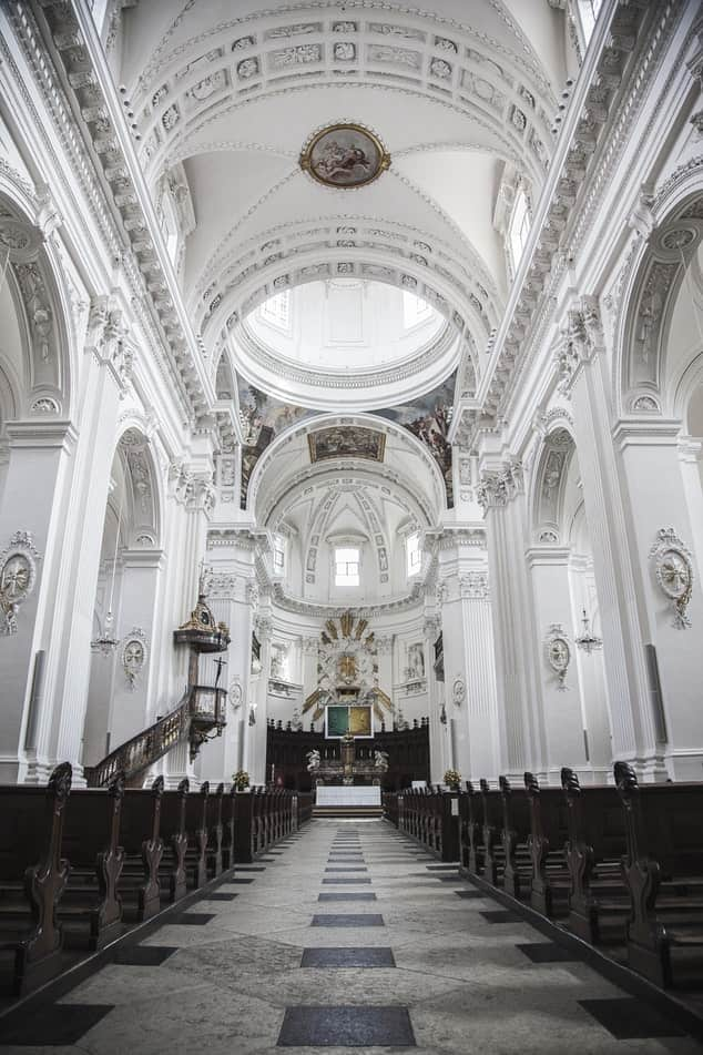 The Basilica of St. Patrick's Old Cathedral with white walls and pews